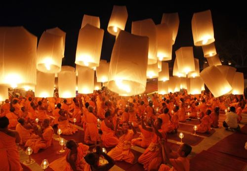 January 9, 2013. Buddhist monks launch paper lanterns into the sky at a temple in Suphan Buri province. The lanterns were released during a traditional pilgrimage to pay homage to Lord Buddha and bless Thailand as it enters the new year.