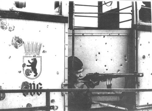 ppsh-41:  Soviet submachine gunner ready to fire in a Berlin tram.