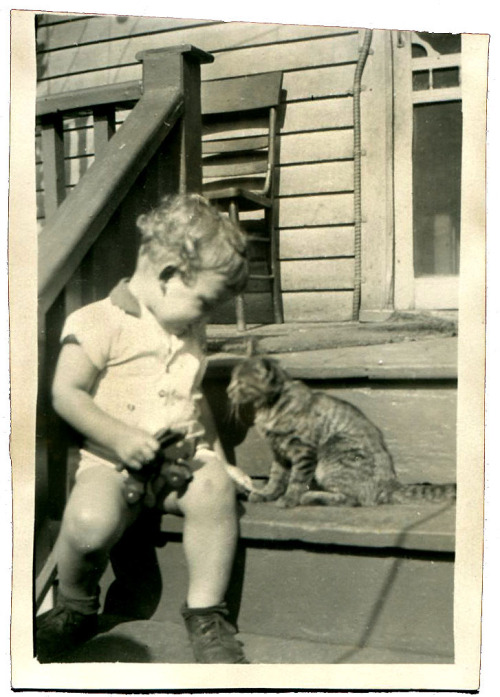 "Edward Zabowski and the ""killer cat,"" as he was known, siting on the back porch of the family home on Mitchell St. in Detroit."