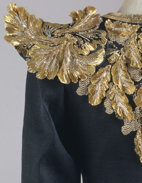 fashioninhistory:  Evening Ensemble (Detail) Yves Saint Laurent Spring/Summer 1980 While a long, lean body remained the ideal in the 1980s, a new, wide shoulder began to be appended to the silhouette. Ornately rendered here by Yves Saint Laurent, the shoulder provided a foundation from which fabric could be draped down to a contrastingly narrow waist. In the hands of some 1980s designers, shoulders were padded out to absurd widths. To a degree, this was a revival of 1940s fashion. Toward the end of the 1980s and into the '90s, historicist revivals by fashion designers have created such a multiplicity of silhouettes that finding the defining one will have to wait.