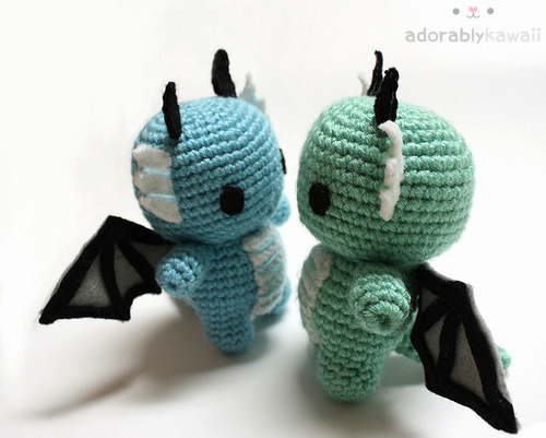adorablykawaii:  Baby Dragon Amigurumi http://www.adorablykawaii.com/http://www.facebook.com/adorablykawaii/http://www.adorablykawaii.etsy.com/  I just wanted to clear this up because I've been getting a lot of messages about my dragon amigurumi since I re-released the pattern. Some people think I copied or based my dragon on All About Ami's dragon (which was based on Oborocharms's artwork) or just based it on Oborocharm's drawing. My dragon was made in 2009 and based on my own drawing. So my amigurumi was made years before All About Ami's and you can see that the drawings are of different designs.  If I'm inspired by someone else's design or use someone else's pattern, it'll say so in the description. I have no problems with giving credit. :)