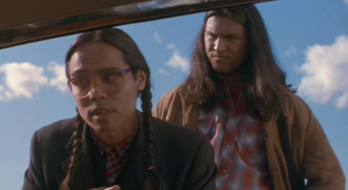 "Smoke Signals (Chris Eyre, 1998) ""[…] Coming out at the tail-end of a certain resurgence of American independent cinema, Smoke Signals is, like many films of the period, an admirably ""well-read"" piece of filmmaking, reflexive of tropes and imagery having come before it. Particularly engaging because of the manner it proudly wears its varied cinematic influences on its sleeve like familiar codes for the audience to recognize and embrace, Chris Eyre crafts a Native cinematic vision that is almost as non-Native in form as it is with its content. Indeed, because it is conventionally and economically shot, the film follows the structure and model of most mainstream (Hollywood, or otherwise) films. While one can only speculate on Eyre's influences and formative film viewing experiences, Smoke Signals does manageto recall a few other key works of non-Native American cinema. Recalling per example fellow satirist Spike Lee (circa 1989's Do the Right Thing), Eyre's use of humor and his handling of ethnic relations in not without a considerable amount of self-parodying, exaggeration and an inch of heavy-handedness. More subtly perhaps, Eyre also overtly appropriates (and embodies) the (arguably White American) road movie genre as popularized by such late-60s films as Bonnie and Clyde (1967) and Easy Rider (1969), while inserting distinct Western imagery (and related jokes) in multiple scenes. At first glance, there might be nothing specifically indigenous to Eyre's filmmaking, yet if slightly disappointing in form, Chris Eyre's use of a normative style to communicate a resolutely Native perspective is an admirable exercise in reappropriation; the interconnected genres of the road movie and the Western (both taking place in and glorifying the open road, so to speak) as given back to the Native filmmaker. […]""  — Turning school assignments into blog material, pardon me."