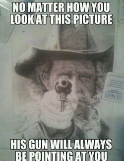 No matter how you look at this picture, his gun will always be pointing at you