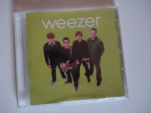 "Weezer - Self Titled (Green) I'm grabbing these at random, but in many ways this is a perfect place to start.I was eighteen and was a diehard Weezer fan back when it meant something.  Weathering the post-Pinkerton storm, happening upon another fan was meant you had an instant connection, and I remember wanting to go to the Outloud shows so bad.This album is about impossible expectations, which is perfect because it was at this time when I finally started dating Abby, who I'd always loved but never had the time right.  The 28:29 was just as anticlimactic after all that longing—it was enjoyable, perfect at moments, but not mindblowing in the way I had hoped.One more important Green Album memory:  I was watching a local band I had mixed feelings about in a Cafe.  Lots of parents there—a somewhat typical audience for a high school coffeeshop band.  The lead singer:  ""We're gonna play this new song by Weezer.  It's called 'Pipe.'""  I quickly corrected him in front of everybody, because I was an asshole like that.  He even bleeped out the H word during the song, which I still think is hilarious. Best song:  Crab"