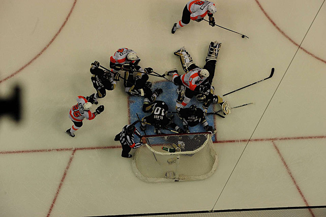 The Flyers and Penguins battle for the puck in front of the Pittsburgh goal during a game between the two in-state rivals last week. Philadelphia won the game 6-5 on Jakub Voracek's goal with 1:31 remaining. (Fred Vuich/SI) KWAK: Voracek emerging as spark for Flyers
