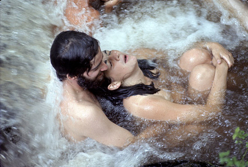 dimestorekeets:  A couple bathe in a waterfall. Woodstock Festival, 1969.  It hurts me to think about it. The couple in the photo should be around 66-68 years old today. I wonder what they are doing at this very moment. I wonder if they are still together or if they broke up and if so why? Did they miss each other, do they still remember this moment at the waterfall? I wonder how they must have felt in the water and the joy they must have experienced. I wonder about their lives…where has life taken them. What has life offered them and taken away? Man, life goes by so quickly. So dam quickly. I wish I could stop my life sometimes and cherish the beautiful moments a little longer. Maybe replay them over and over so that I don't miss a thing. But they must slip away with time. Only in my hearts memory will they forever stay alive.   Nothing is guaranteed in life except for the fact that you will die. Everything else is unpredictable.