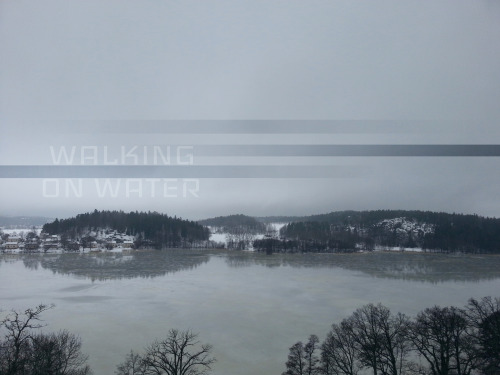 "Android Editors Member Submission by Jacob Dix Title: ""Walking On Water"" Description:The shot was taken overlooking the lake from the cliffs behind the church where I was married,  and where my wife and I baptized our two children. I do not believe the particular story of Jesus walking on water was an accurate account,  but a dream of Peter. But the church premises and the ice which I still find hard to walk on in this Scandinavian landscape brought up thoughts of the miraculous. Sometimes life throws you surprises, one of which inspiring this image. Editing Process:The shot was adjusted using levels in Photo Editor. I then exported it to PS Touch. The stripes are just duplicated sections of the image made into their own layers, using the multiply filter at about 30% and in combination with fading opacity. I made a black background layer with white text in Photo Editor. The typeface is called ""Iceland"", which I thought fitting. I added this as a layer in PS Touch using the ""lighten"" layer feature, at 20% opacity to give a hint of the text, nothing more. Save and done."