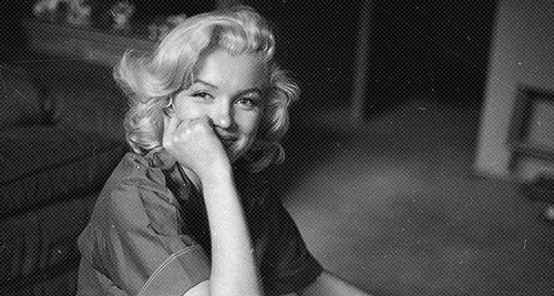 """her eyes were sad, even when she smiled"".  Marilyn by Milton H. Greene."