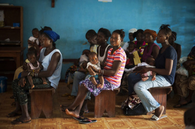 "Photo: Mothers await vaccinations for their children at the Bumpe Government Clinic in Bo District. Sierra Leone 2012 © Lynsey Addario/VII ""Decade of Vaccines"" Blueprint Ignores High Prices, Lacks Ambition on Better-Adapted Vaccines to Help Reach More Children Governments meeting at the World Health Organization's Executive Board this week must seize the opportunity to improve serious shortcomings in the document that will drive the global community's vaccines response for the next decade. If they fail to do so, some of the key reasons for why millions of children continue to die of vaccine preventable causes will be left unaddressed. Countries will decide how to assess the success and steer the activities of the ""Global Vaccine Action Plan,"" a $50-billion vaccine initiative for the developing world. Although the high price of some vaccines threatens many countries' abilities to sustain its vaccine programs, the Vaccine Action Plan so far does not include any measures to monitor or control prices. ""The cost of vaccinating a child has risen by 2,700 percent over the last decade, so it is puzzling that the vaccines blueprint for the next decade does not have a goal to bring prices down,"" said Dr. Manica Balasegaram, executive director of MSF's Access Campaign. ""Governments in countries where we work are increasingly worried about how they will foot the bill for vaccines when donor support tapers off."""