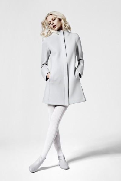 womensweardaily:  Courrèges Unveils Collection for La Redoute  [above: Aline Weber in a Courrèges coat with magnet fasteners, priced at 299 euros to $391 at current exchange. Photo By Courtesy]