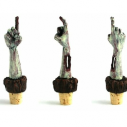Okay, if I drank wine, I would totally buy these. (via Severed Zombie Hand Wine Cork - The WHOA! Shop)