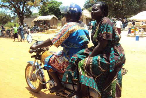 "Female boda boda cyclist rides route where few women dare: Determined. Ms Matilda Igama, a mother of seven, has been a boda boda cyclist in Adjumani for two years.   It is unusual to spot a female boda boda rider in Madi Sub-region, which covers the two districts of Moyo and Adjumani. Passengers first hesitate and some stare in disbelief when Ms Matilda Igama calls out to them to sit on her motorbike.    Ms Igama has made history by taking a bold decision to take on the business of riding a motorcycle for commercial gain, making her the ""first ever female boda-boda rider"" in the sub-region.    She clocked two years in the business last month and is vowing to continue doing the same. She was previously dealing in retail business in Adjumani Town but decided to cross over to transporting passengers at a fee. (Full story at Daily Monitor)"