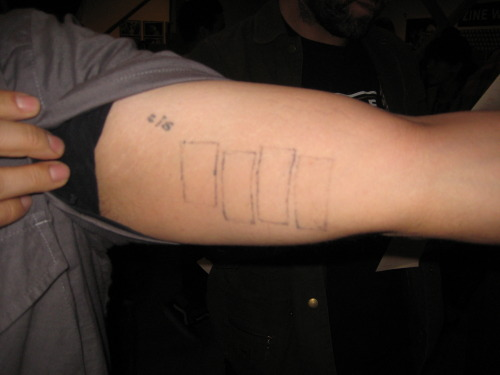 Documentation of a Black Flag tattoo, created by the arm's owner using a tattoo gun that he made from the motor in a set of electric hair clippers. Taken this past weekend at the L.A. Art Book Fair.