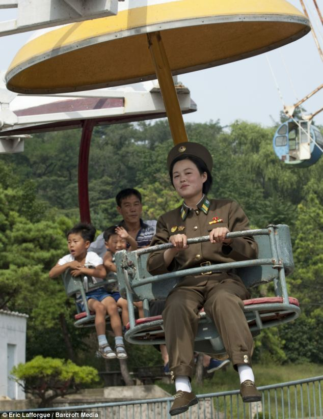 Communist soldiers of North Korea have fun at the fair as incredible images capture army during 'downtime' | Mail Online