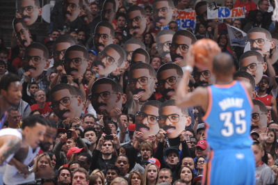 nba:  Cardboard cutouts of Cliff Paul are shown while Kevin Durant of the Oklahoma City Thunder shoots a free throw at Staples Center on January 22, 2013 in Los Angeles, California. (Photo by Andrew D. Bernstein/NBAE via Getty Images)  too mainstream.