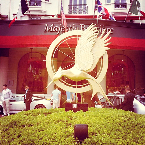 Catching Fire's mockingjay statue makes a statement in front of the Majestic Hotel at Cannes Film Festival 2013.