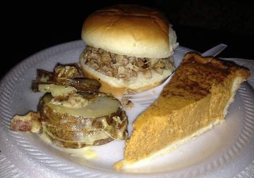 Pulled BBQ sandwich, loaded baked potato au gratin and a slice of pumpkin pie!