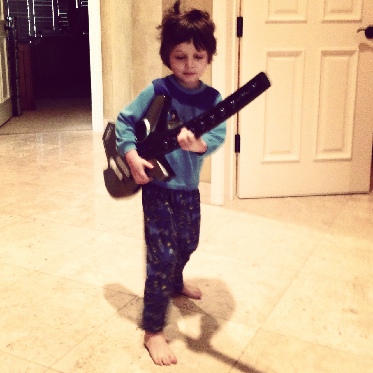 "thedaddycomplex:  ""Look, Papa. I'm playing rock 'n' roll."" —Wyatt"
