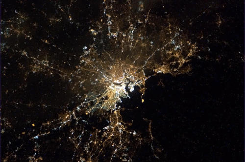 colchrishadfield:  Boston at night, glowing under a trace of fog.