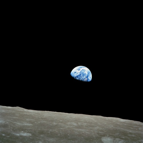 crookedindifference:  Happy Earth Day: Earthrise  One of the most famous aspects of the Apollo 8 flight was the Earthrise picture that was taken as they came around for their fourth orbit of the Moon. This was the first time that humans had taken such a picture whilst actually behind the camera, and it has been credited with a role in inspiring the first Earth Day in 1970. It was selected as the first of Life magazine's 'hundred photos that changed the world'. Taken by Apollo 8 crewmember Bill Anders on December 24, 1968, showing the Earth seemingly rising above the lunar surface. Note that this phenomenon is only visible from someone in orbit around the Moon. Because of the Moon's synchronous rotation about the Earth (i.e., the same side of the Moon is always facing the Earth), no Earthrise can be observed by a stationary observer on the surface of the Moon.
