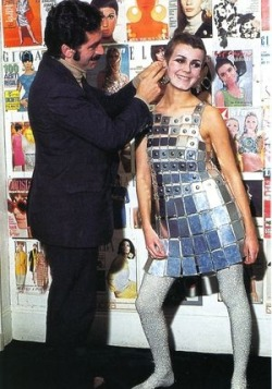 Paco Rabanne with a model wearing a tunic-dress made from strips of aluminum, 1968