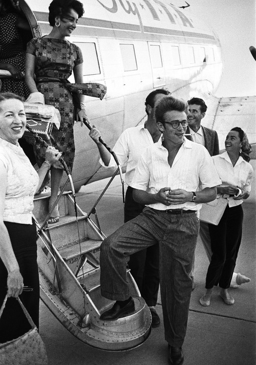jamesdeandaily:  James Dean and Elizabeth Taylor board the plane to Texas, photographed by Richard Miller, 1955.