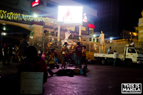 Calm before the storm A man lies down Plaza Miranda the night before the procession of the Quiapo's Black Nazarene. January 8,2013|Quiapo,Manila