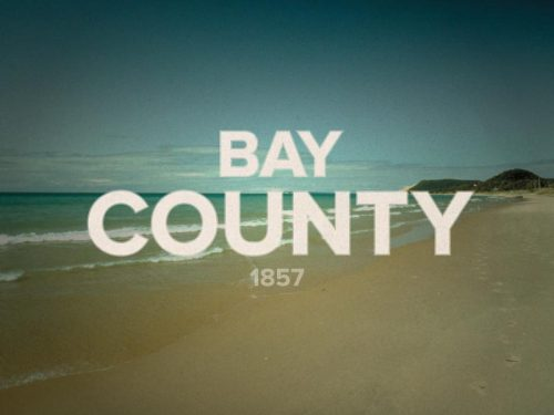 "Bay County was created in 1857 from portions of Midland, Arenac, and Saginaw counties. Its name origin is that it ""surrounds Saginaw Bay."" 9/83"