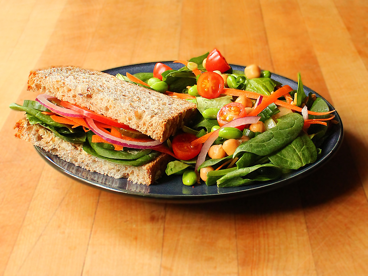 Vegetable sandwich on sprouted whole grain bread... | Garden of Vegan