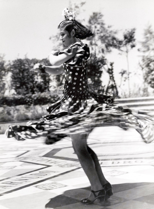 Whirling flamenco dancer with a wide skirt. Seville, Spain, 1934.