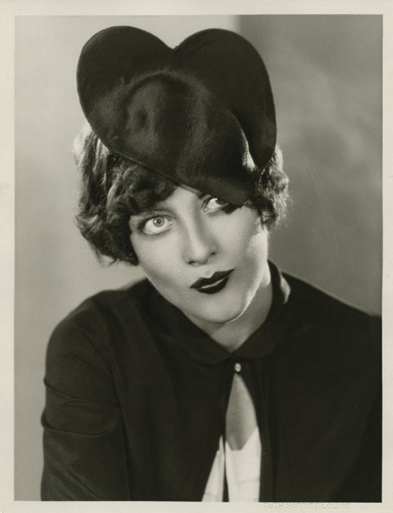 Young Joan Crawford with the cutest heart hat!