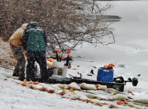 Ice anglers unload their gear after a day of fishing on Lake George, Feb. 2, 2013.