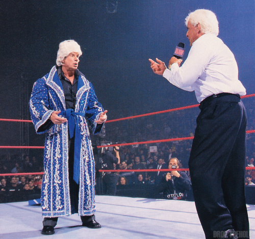 """The Nature Boy"" Vince McMahon and Ric Flair - WWF RAW [1/7/2002] To fully illustrate the difference of the audience and general attitude (no pun intended) between today's crowds and the crowds of a decade ago, as soon as Vince McMahon started to put on the Ric Flair robe and wig, he was bombarded by an immediate ""ASSHOLE"" chant. Regardless, this was a fun segment that ended up McMahon pulling out a lead pipe leaving Ric Flair a bloody mess in the middle of the ring."