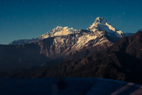 rucksackandacamera:   Annapurna 1 (left, 8091m) and Annapurna South (right, 7219m) lit by a full moon in January 2013. The view was from my bedroom for the night in Ghorepani. What an amazing view! Going to sleep with an easy view of several 8000+ meter mountains is just great!
