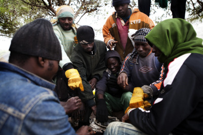 "Photo:Migrants in the Gourougou are mostly young men from West Africa who say they had to leave home due to poverty and no hopes of finding a job. In Europe, they say, they have dreams of getting education and earning money to send home to their families. Morocco 2012 © Anna Surinyach Migrants in Morocco: ""We Live Like Prehistoric Men"" In northwestern Morocco, in the forests of Gourougou Mountain, several hundred African migrants are living covertly in remote makeshift camps, struggling to survive, and waiting for an opportunity to enter Europe. They are mostly young men from West African countries who have left their homes because they had no way to make money and who have left behind family members who are reliant on them, in the hopes of sending back support. Having gained the trust of these migrants, who hide because they are frequently targeted by the authorities, Doctors Without Borders/Médecins Sans Frontières (MSF) conducts monthly mobile medical clinics to their camps, providing primary health care, distributions, and psychological support."