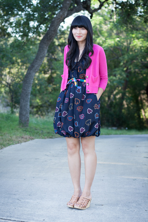 "2013. polly pocket. stitchview cardigan by madewell. la la leaves dress by marc jacobs. thrifted sash. gloria wedges by bed stu.i've owned this dress almost as long as i've been blogging. it's a quintessential ""linda"" dress (navy blue, quirky print, pockets) and it compliments most of the cardigans in my closet. i wore it to school last week with a hot pink sweater and a 99¢ belt.our intermittent internet (say that three times fast) of the last few weeks appears to be back to normal; michael thinks our network had a glitch or two. i spent our downtime gardening, doodling, cleaning, and excercising! i'm excited about posting regularly (again) and sharing some new designs in my etsy shop. i hope the sun is shining wherever you are.the look 