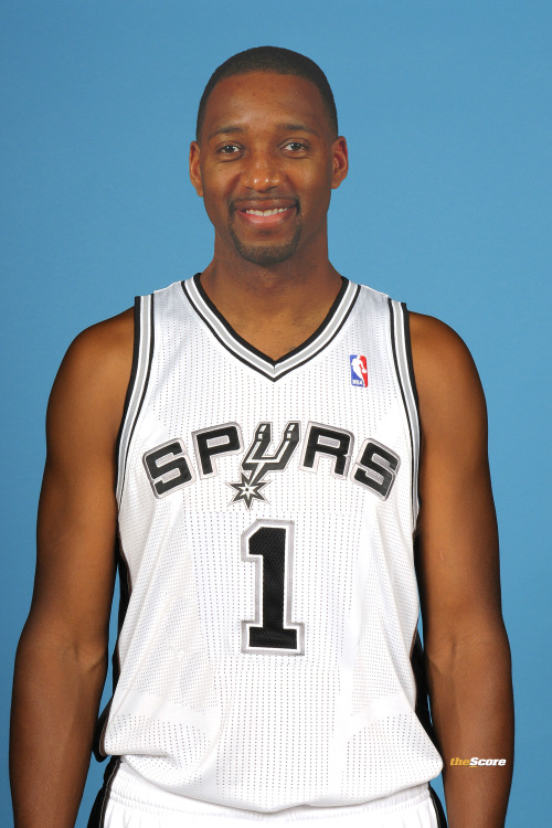 nbaoffseason:  thescore:  Pic: T-Mac wearing his San Antonio @Spurs jersey.  T-MAC BACK!