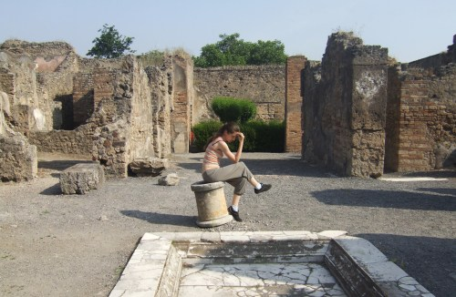 the ruins of Pompeii and me a bit fooling around The city of Pompeii is a partially buried Roman town-city near modern Naples in the Italian region of Campania, in the territory of the comune of Pompei. Along with Herculaneum and many villas in the surrounding area, Pompeii was partially destroyed and buried under 4 to 6 m (13 to 20 ft) of ash and pumice in the eruption of Mount Vesuvius in AD 79. (wiki) photos from Mount Vesuvius