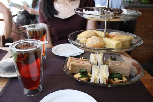 $24 Groupon of afternoon tea for two at Sanctuary T! Amazing! Highly recommended for the quality teas, food, and hospitality (well, for the most part*).[[MORE]]It's a regular price of $24 per person. Afternoon tea takes place 3-5pm on Mon-Thurs with unlimited teas and treats. *However, when my aunt and I asked for a second serving of the tiers, we were declined and told that they only had a certain amount of treats made per day, per afternoon tea reservation. It was either a sneaky tactic to claim they're unlimited, or they're unorganized in lacking to specify that you have to confirm for more than one serving.Putting that unsatisfactory note aside, Goyee and I really enjoyed everything that was prepared. Our teas were served in a nicely sized cup with a generously filled tea strainer. Their tea menu, btw, is a pleasant array of black, herbal, green, white, and more; a few of them being organic and/or fair trade.We started our nibbling with the sandwiches, which were two types: salmon and egg salad. The salmon was citrus-cured and put together with creme fraiche. The egg salad had an amazing accent of truffle oil. These were accompanied by a crostini that had garbanzo puree and crisp kale. Very delicious.The scones, which weren't as dry as traditional scones, came with the standard clotted cream and jam. The tier also came with lemon teacakes and warm Nutella-filled doughnuts.Lastly, the bites were finished with petit fours: melt-in-your-mouth rosemary caramels (!) and dark chocolate bonbons with osmathus ganache. Unique and impressive.The crostini, teacakes, doughnuts, and petit fours aren't traditional selections in an afternoon tea, but it's certainly a praiseworthy, contemporary interpretation. It's interesting that they nixed turkey and cucumber sandwiches. Don't get me wrong, though — I'm in love with their salmon+creme fraiche and truffle egg salad sandwiches. I'd definitely consider coming back again.
