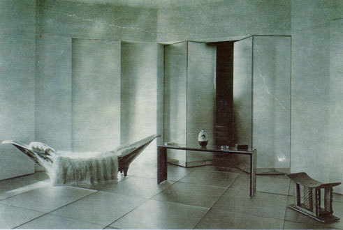 rue de lota apartment with pirogue sofa, eileen gray