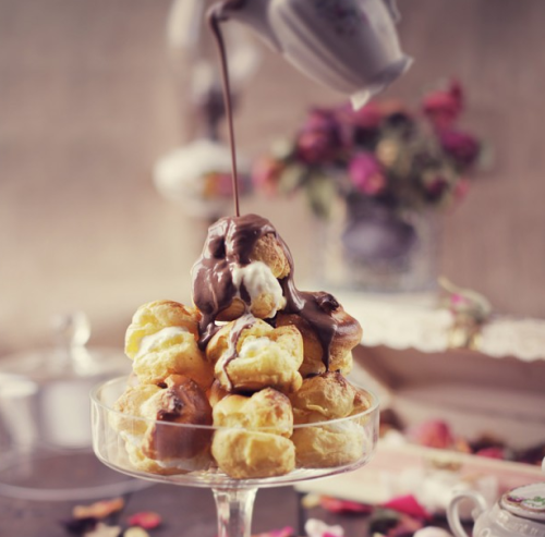gastrogirl:  ice cream filled profiteroles with chocolate sauce.