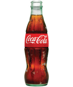 REVIEW: Coca-Cola  Writing about Coca-Cola is like writing about the world as a whole. One could break down how they experience what we call Earth by compartmentalizing, categorizing, and quantifying, but it be to no avail. There isn't a way to encapsulate all of worldly existence into a piece of writing. However, this doesn't mean that people shouldn't at least try to understand the world through writing, art or scholarly endeavors. It is a similar futility that one faces writing about Coca-Cola Classic. Although reviewing Coke might be a herculean task fit for no mortal man, it does not mean that we should not strive to understand this beverage that stands firmly and confidently as the undisputed king of soda world.  It is not enough to taste Coke to understand it. There is so many contexts surrounding the beverage so unless you live in a complete cultural bubble, it is impossible to drink it without also drinking in what coke means to other people as well. It is a giant global brand and people all over the planet have different conceptions and interactions with the drink. This is evident even in just the number of Coca Cola shirts you see written in different languages. A company does not get so big without scrutiny or controversy. It is widely noted that Coke represents a certain height of cutthroat American capitalism with all of its ills. The company boasts a terrible environmental record, often-horrifying labor practices, and even a record of bribing public officials to minimize its negative health consequences. However, if we are to think as Coke as a mini-world in and of itself, we can begin to accept it with all of its flaws and evils. Like the world, like every person, coke is both horrible and beautiful. Ignoring all other factors Coke is one of the best—if not the best – flavor of soda available. The recipe has been subject to high profile corporate espionage and has remained a tightly guarded secret throughout the company's history. It no longer contains cocaine (the only thing that could make it better) but it is known that the Kola bean is not actually a contributor to the flavor but rather vanilla, cinnamon and spices that contribute to the unique flavor. Many of the reported leaked recipes contain similar ingredients—but the proportions of each ingredient are subject to much debate. Whatever the secret may be, the drink is nearly flawless. Crisp, refreshing, acidic, the right amount of sweet, a pleasant burning sensation, it is carbonated delight.  The gritty details you'll are scrutinized: Mexican coke made with cane sugar is superior. A glass bottle adds to the drinking experience. But whatever way you drink—Coke is still the best. Everyone will have a different preference for their enjoyment, be it can, bottle, glass, or fountain. Each is a different experience and we all bring our selves to these experiences to synthesize them into the amorphous concept that we understand as Coke. Drinking coke isn't just drinking a soda. It's not just the iconic branding, the nostalgia for historical America, the bubbles, the flavor, the stimulant rush—it's about memories. Coke has played a reoccurring role in most people's lives. Many remember it on hot summer days, near playgrounds, at parties, at a ball game, in the desert, on a beach… the possibilities are endless. Coke is part of life. It is life. It is part of the world. It is a world. And in the world of soda, it is the pinnacle, the apex, the standard by which all soda is judged.  Grade: A+ (Jacob)