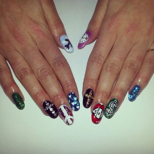 "Did these fabulously sparkly ""New Year Resolution nails"" for @thebeautyfox_xo Can you guess her resolutions?? #nailart #nails #NYEmani #instanails"