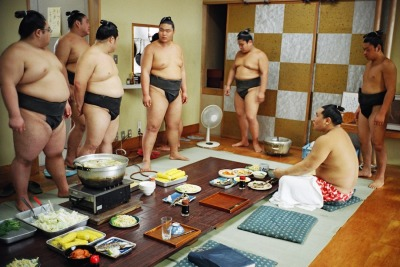 "The Daily Life Of Sumo Wrestlers By Paolo Patrizi   The wrestlers live, eat, and practice together at the stables. Exercises start around 6 a.m. with the juniors. A wrestler challenges an opponent, and he stays in the ring until someone beats him. At 8 a.m., Patrizi said, the more senior wrestlers come in and things get interesting.   ""Some of the tough guys pick on the younger ones, and they trash them. There's some serious beating going on. There's a lot of bullying going on, but these guys keep quiet. They can't complain,"" he said.   Training is grueling. When the sumos do go out, Patrizi said, it's most often on a Sunday, their day off. He says they sometimes rent videos or play video games. - Slate"