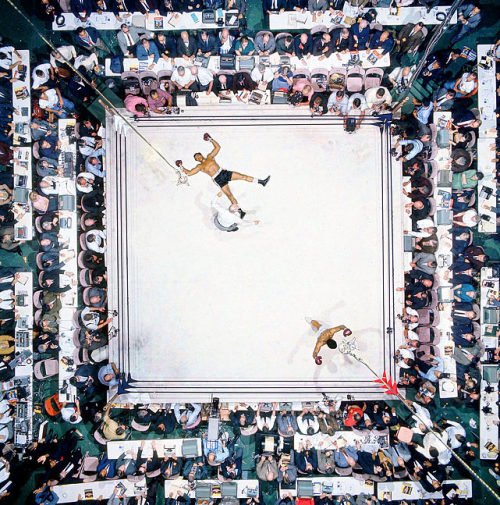 siphotos:  Muhammad Ali knocks out Cleveland 'Big Cat' Williams in three rounds at the Houston Astrodome to defend his heavyweight title in November 1966. The bout drew a record indoor crowd of 35,460. (Neil Leifer/SI) GALLERY: SI's 100 Greatest Sports Photos