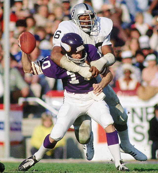 Oakland Raiders defensive end Otis Sistrunk sacks Fran Tarkenton, forcing the Minnesota Vikings quarterback to fumble. Oakland's offense had a field day with the Vikings, setting a Super Bowl record with 429 yards of offense in the 32-14 win. (Walter Iooss Jr./SI) GALLERY: SI's 100 Best Super Bowl Photos
