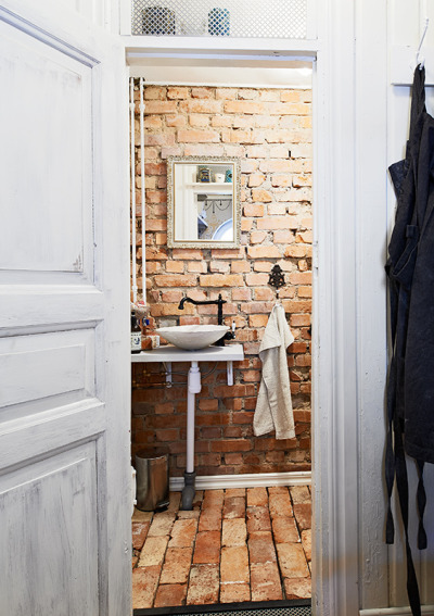 myidealhome:  bathroom with raw exposed bricks (via stadshem)