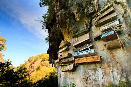 shuttertrip:  The Hanging Coffins. Sagada, Mountain Province, Philippines. Just came from Sagada! I have so many pending photos to post from recent travels and I'll go through them one by one during the Holidays. In the meanwhile, I'm posting this one. Sagada's about 12-14 hours drive from Metro Manila (so long) but the view going there is nothing short of spectacular (I'll show you in another post). The scene in the photo is one of the main attractions that gives Sagada its identity. About half an hour trek (with panoramic views of the mountains) would get you to this one. More photos to come!