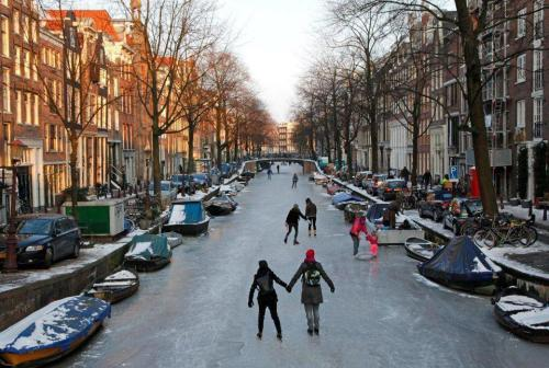 Frozen Canal, Amsterdam, The Netherlands photo via wendy