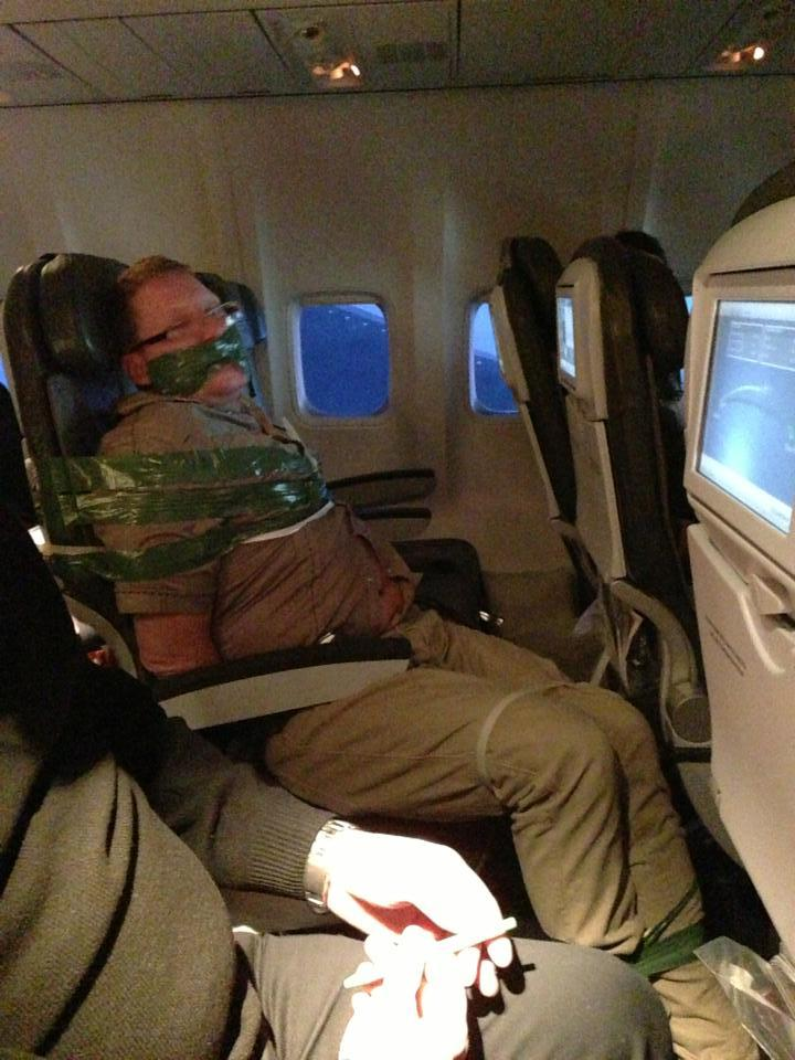 andyellwood:  Passanger drank all of his duty free liquor on the flight from Iceland to JFK yesterday. When he became unruly, (i.e. trying to choke the woman next to him and screaming the plane was going to crash), fellow passengers subdued him and tie him up for the rest of the flight. He was escorted off the flight by police when it landed.    This is front news in my paper today hahaha